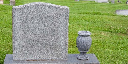 Headstone and vase in a cemetery
